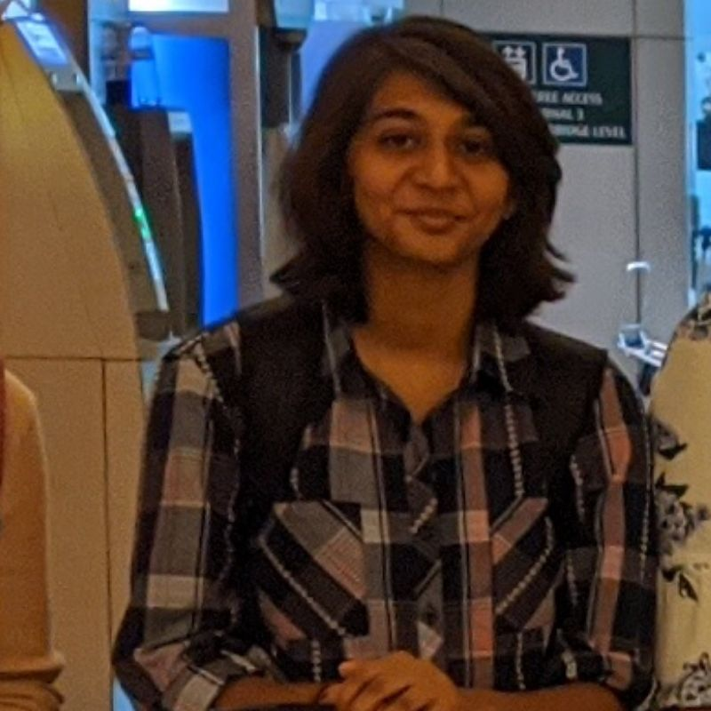 girl wearing checked shirt smiling