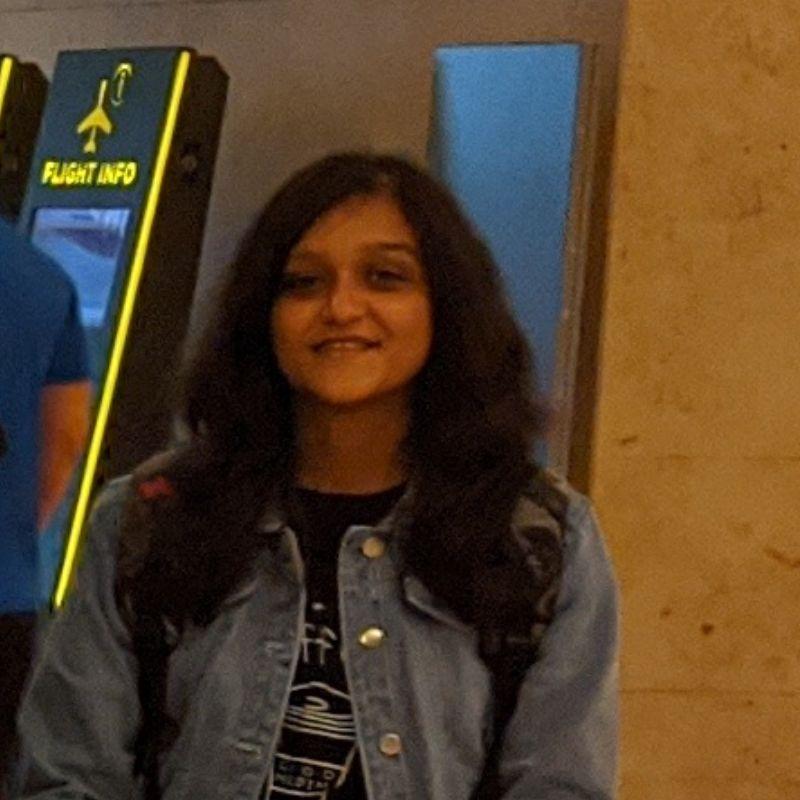 girl wearing jacket smiling