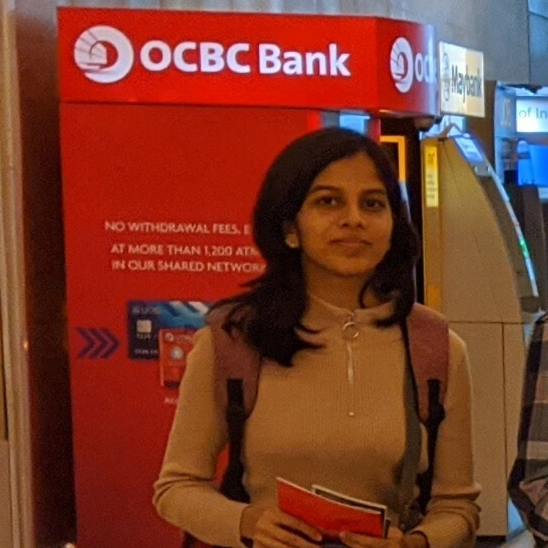 girl in front of atm
